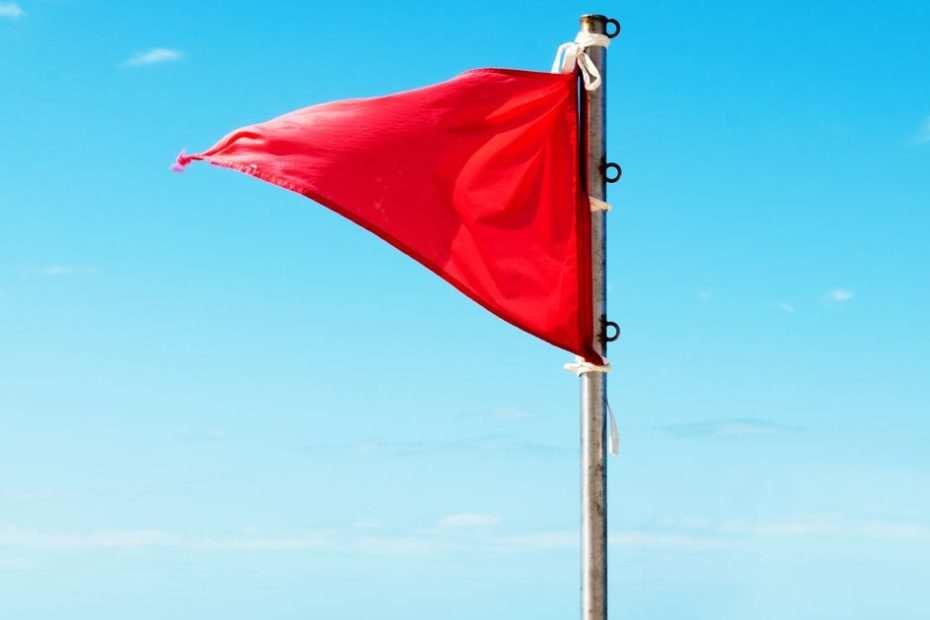 Emoji of red flags are all over Twitter. Here's why